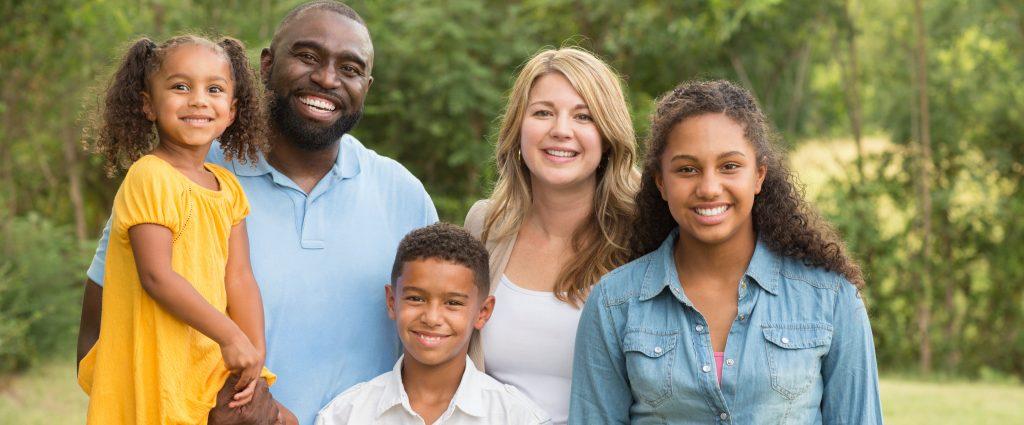 Foster family outside family portrait